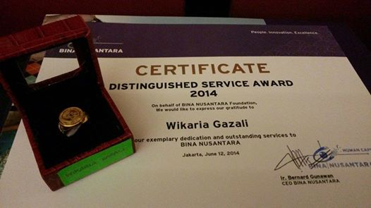 Distinguished Service Award 2014 on behalf of BINA NUSANTARA Foundation, We would like to express our gratitude to WIKARIA GAZALI for your exemplary dedication and outstanding services to BINA NUSANTARA Jakarta, June 12, 2014